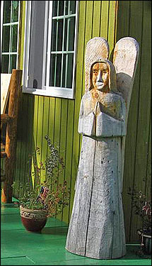Picture of Wooden Angel Sculpture on the porch of the Bed and Breakfast