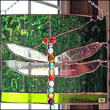 Dragonfly on Green Bulls Eye Glass